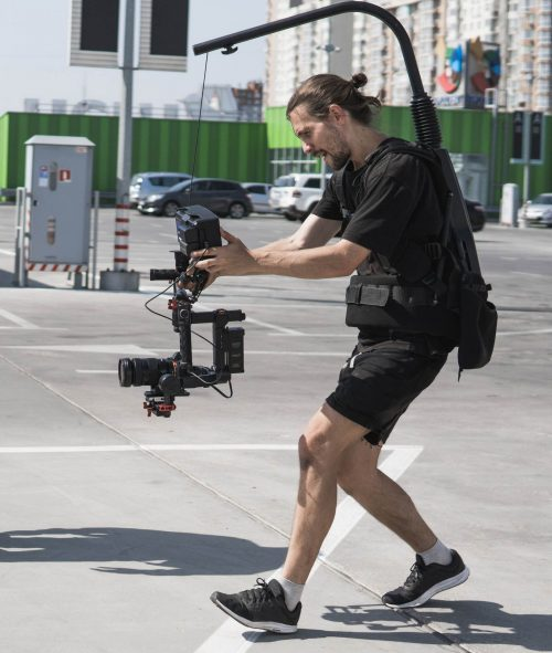 Image of our staff at  Elite Video of Colorado Springs shoowing some footage out in a parking lot.